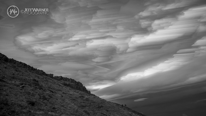 Fast-moving clouds over North Table Mountain, Golden, CO.