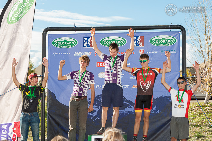 Reade on the podium accepting 2nd Place, head held high.