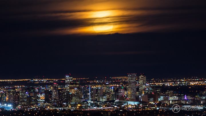 SuperMoon rises over the Denver skyline